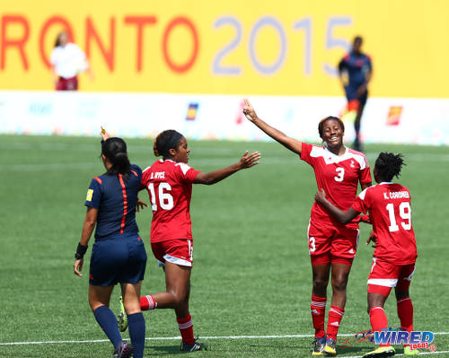 Photo: Trinidad and Tobago goal scorer Mariah Shade (centre) celebrates with teammates Kennya Cordner (right) and Brianna Ryce during their 2-2 draw with Argentina at the Toronto 2015 Pan American Games. (Courtesy Allan V Crane/Wired868)