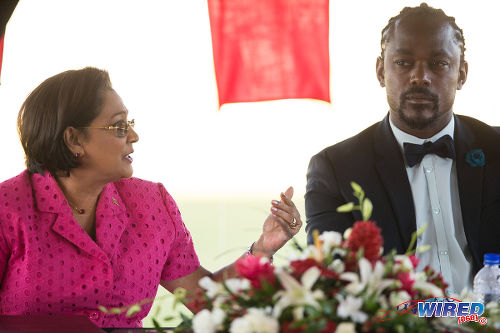 Photo: Prime Minister Kamla Persad-Bissessar (left) has a word with Sport Minister Brent Sancho during the opening of the Irwin Park Sporting Complex in Siparia on August 26. (Courtesy Allan V Crane/Wired868)