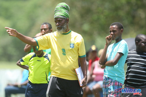 "Photo: Trendsetter Hawks coach Anthony ""Dada"" Wickham points the way during 2015 Republic Bank National Youth Cup action at the Queen's Park Savannah.  (Courtesy Allan V Crane/Wired868)"