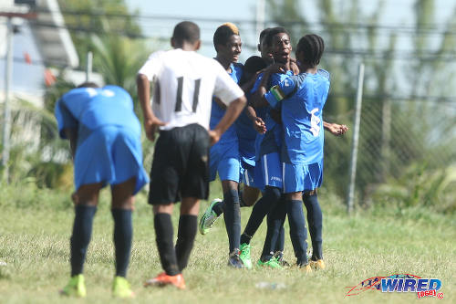 Photo: Uprising Youths player Zyon Bristol (second from right) is congratulated by teammates after his decisive goal against Crown Trace FC in the Republic Bank National Youth Cup quarterfinals. (Courtesy Allan V Crane/Wired868)