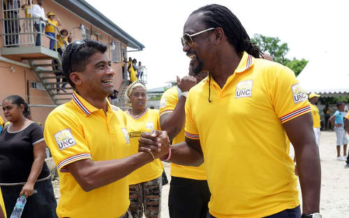 Photo: Former Sport Minister Brent Sancho (right) greets fellow UNC member Glenn Ramadharsingh on the campaign trail before the September 6 general election.