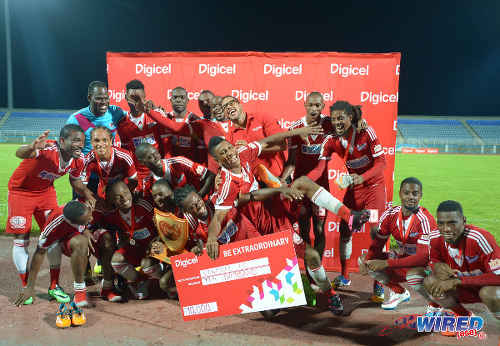 Photo: Central FC players celebrate lifting the 2015 Digicel Charity Shield title after a 1-0 win over rivals W Connection last night. (Courtesy DPI Photography/Wired868)