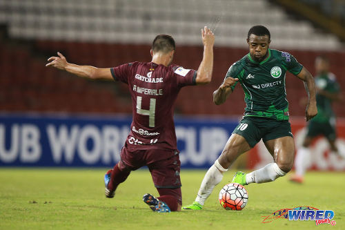 Photo: W Connection attacker Jomal Williams (right) dances around Deportivo Saprissa defender Andres Imperiale during CONCACAF Champions League action last night. (Courtesy Allan V Crane/Wired868)