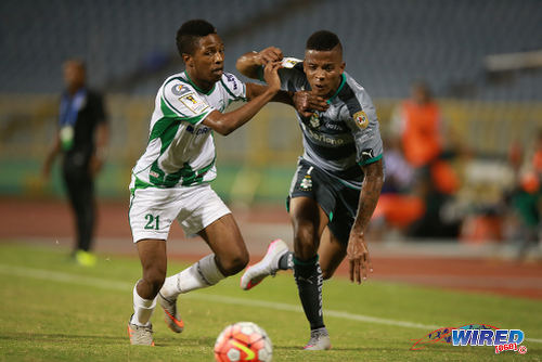 Photo: W Connection right back Shannon Gomez (left) tries to keep up with Santos Laguna winger Andres Renteria during CONCACAF Champions League action yesterday at the Hasely Crawford Stadium, Port of Spain. (Courtesy Allan V Crane/Wired868)