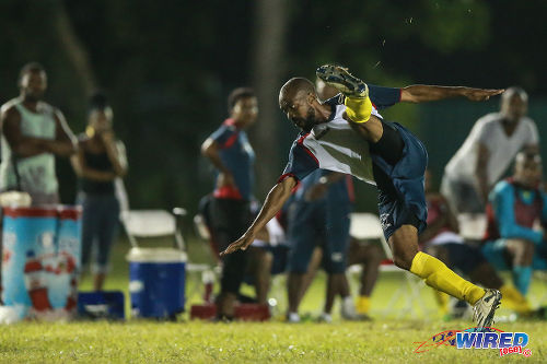 Photo: Edinburgh 500 Kelonne Cazoe crashes to the ground during CNG National Super League Championship Division action against Malabar FC at the D'abadie Recreation Grounds.  (Courtesy Allan V Crane/Wired868)