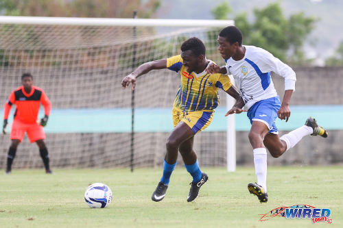 Photo: Fatima College's Jonathan Casimire (left) tries to hold off Presentation College's Kori Cupid in 2015 SSFL action. (Courtesy Allan V Crane/Wired868)