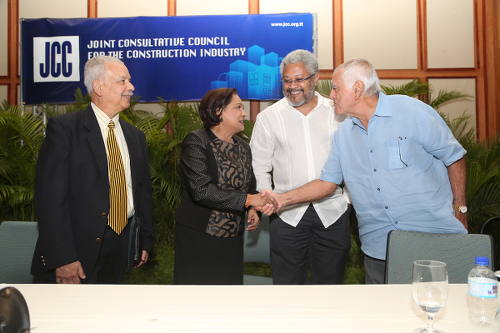 Photo: Former Trinidad and Tobago Prime Minister Kamla Persad-Bissessar (second from left) greets JCC founder Emile Elias (far right) while then JCC president Afra Raymond (second from right) looks on.