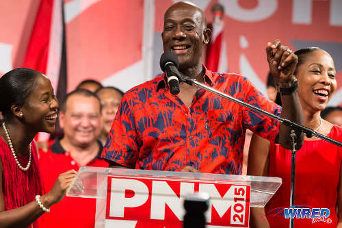 Photo: PNM political leader Dr Keith Rowley (centre) gives his victory speech at Balisier House on 7 September 2015, flanked by his wife Sharon Rowley (right) and daughter Sonel. (Courtesy Allan V Crane/Wired868)