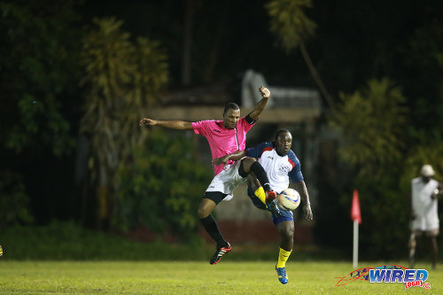 Photo: Malabar FC captain Marvin Springer (left) challenges Edinburgh 500 substitute Milton Wilson for possession during a previous CNG National Super League clash at the D'Abadie Recreation Grounds.  (Courtesy Allan V Crane/Wired868)