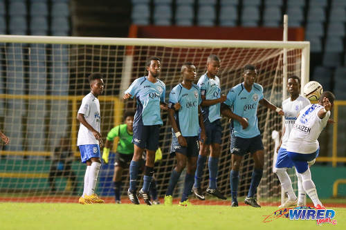 Photo: Naparima College midfielder Judah St Louis (far right) hits a brilliant free kick over the QRC wall for his team's second goal. (Courtesy Allan V Crane/Wired868)
