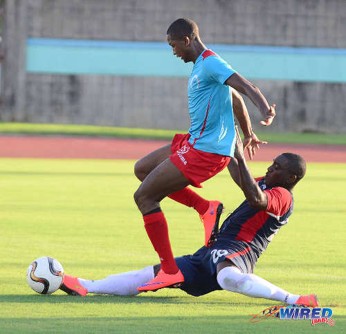 Photo: Marabella Family Crisis Centre winger Kurlan Khan (left) tries to ride a challenge from Police FC veteran midfielder Trent Noel during a previous CNG NSL contest. (Courtesy DPI Photography/Wired868)