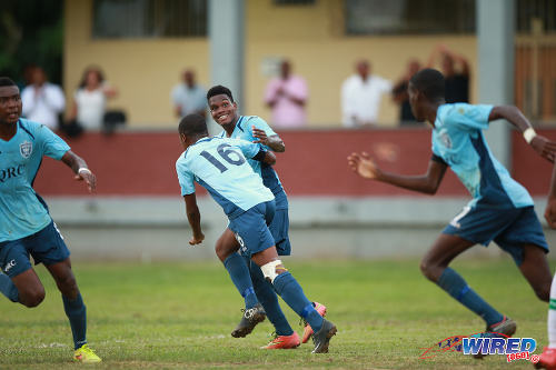 Photo: QRC midfielder Demetri Dunkley (centre) sprints off with his teammates after his goal against St Augustine Secondary in the 2015 SSFL season. (Courtesy Allan V Crane/Wired868)