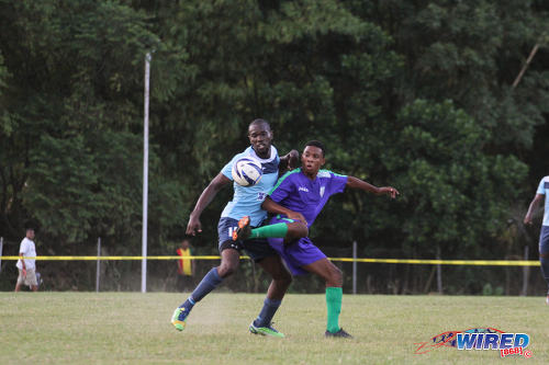Photo: A Club Sando player (right) tries to outfox an opponent from Real Maracas during NSL action yesterday. (Courtesy Sinead Peters/Wired868)