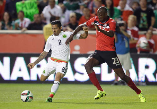Photo: Trinidad and Tobago defender Daneil Cyrus (right) tries to close down Mexico midfielder Javier Aquino in last Friday's friendly international in Utah. (Courtesy TTFA Media)
