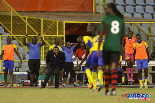 Photo: Defence Force coach Marvin Gordon (third from left) and his substitutes' bench erupts after Jerwyn Balthazar's screaming strike against San Juan Jabloteh in the 2015 First Citizens Cup. (Courtesy Chevaughn Christopher/Wired868)