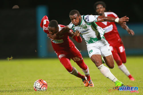 Photo: W Connection attacker Jomal Williams (right) drives past Central FC defender Kaydion Gabriel during the First Citizens Cup final last night in Couva. (Courtesy Allan V Crane/Wired868)