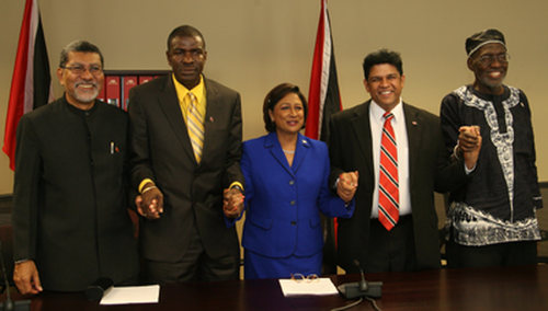 Photo: Former Trinidad and Tobago Prime Minister Kamla Persad-Bissessar (centre) with fellow People's Partnership leaders (from left) David Abdullah, Ashworth Jack, Prakash Ramadhar and Makandal Daaga during their term in office. (Copyright Trinidad Guardian)