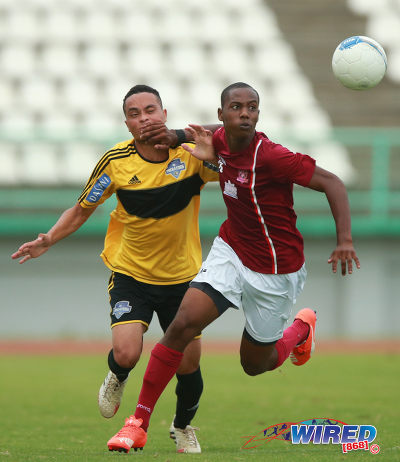 Photo: NLCB La Horquetta SA defender Kerron St Cyr (right) holds off Cunupia FC attacker Eduardo Guedes during CNG National Super League KO action at the Larry Gomes Stadium, Malabar. (Courtesy Allan V Crane/Wired868)