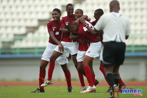 Photo: La Horquetta SA scorer Taje Commissiong (third from left) is congratulated by his brother Cedric Commissiong (second from left), captain Atiba Hackette (far left) and his teammates after his decisive strike against Cunupia FC in the CNG NSL Knock Out fixture at the Larry Gomes Stadium, Malabar. (Courtesy Allan V Crane/Wired868)
