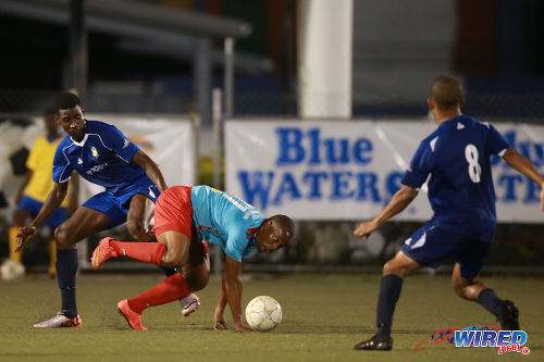 Photo: Marabella Family Crisis Centre substitute Arvid Applewhite (centre) tries to force his way between FC Santa Rosa players Claudius Howard (left) and Shaka Pilgrim during CNG NSL Premiership Division action in Macoya. (Courtesy Allan V Crane/Wired868)