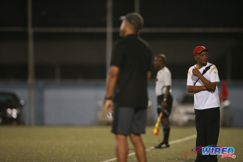 Photo: Marabella Family Crisis Centre coach Terrence Boissiere (right) follows the action from the sidelines yesterday in Macoya. FC Santa Rosa coach Keith Look Loy is in the foreground. (Courtesy Allan V Crane/Wired868)