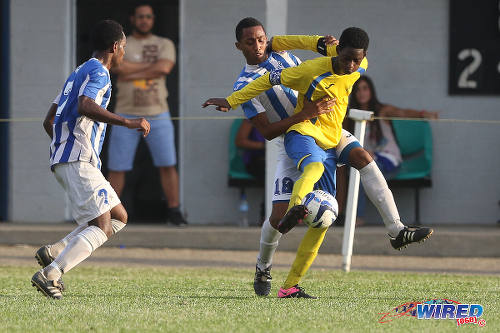 Photo: Shiva Boys HC stand-in captain Shaquille John (right) holds off St Mary's College player Joshua Joseph during SSFL Premier Division action at Serpentine Road. (Courtesy Chevaughn Christopher/Wired868)