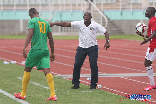 Photo: Guaya United coach Akeno Morgan yells instructions at striker Carlon Hughes (left) during the CNG NSL KO final against Petrotrin Palo Seco. (Courtesy Chevaughn Christopher/Wired868)