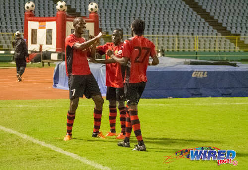 Photo: San Juan Jabloteh players (from left) Jamal Gay, Fabian Reid and Nathan Lewis celebrate a goal against Guaya United in the 2015 Toyota Classic quarterfinal round at the Hasely Crawford Stadium. (Courtesy Amigo Garraway/Wired868)