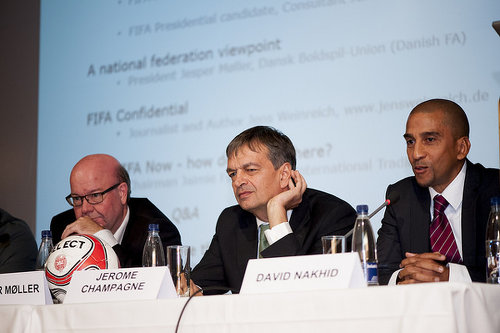Photo: FIFA presidential candidate  Jerome Champagne (centre) cups his ear while he listens to a question during the 2015 Play The Game conference Aarhus, Denmark in October. Champagne is flanked by David Nakhid (right) and Denmark FA president Jesper Møller. (Copyright Thomas Søndergaard/Play The Game)