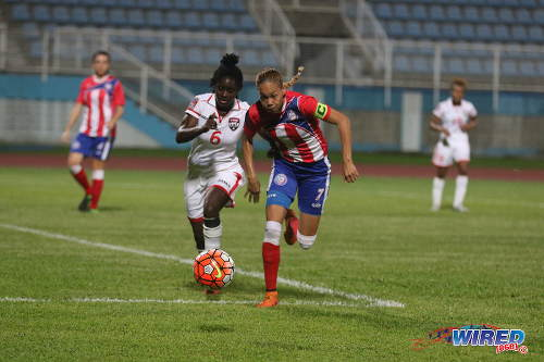 Photo: Puerto Rico captain Delyaliz Amber (right) beats Trinidad and Tobago flanker Khadidra Debesette to the ball during 2016 Olympic qualifying action at the Ato Boldon Stadium in Couva. (Courtesy Chevaughn Christopher/Wired868)