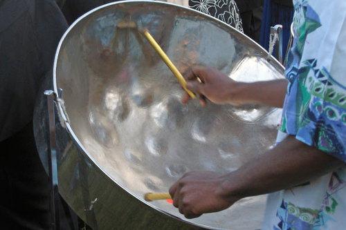 Photo: Playing steelpan. (Copyright Songsofthecosmos)