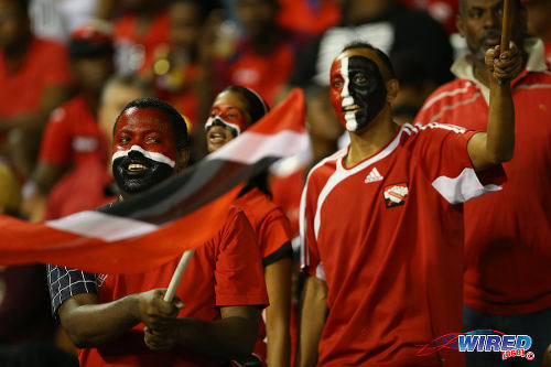 """Photo: Trinidad and Tobago football fans get behind their team at the Hasely Crawford Stadium. The """"Soca Warriors"""" played to a goalless draw tonight against the United States in 2018 World Cup qualifying action. (Courtesy Allan V Crane/Wired868)"""
