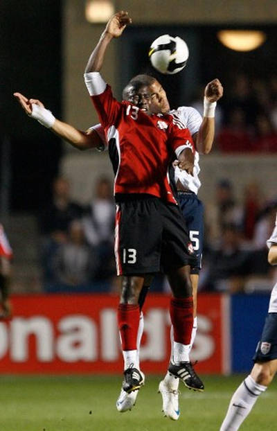 Photo: Trinidad and Tobago striker Cornell Glen (front) jumps for the ball with United States defender Oguchi Onyewu during 2010 World Cup qualifying action. (Copyright AFP 2015)