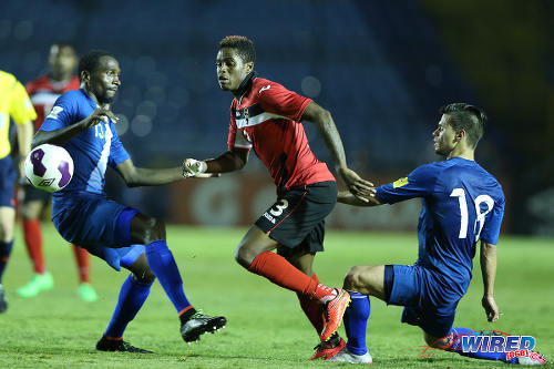 "Photo: Trinidad and Tobago midfielder Joevin Jones (centre) slips past Guatemala defenders Dennis Lopez (left) and Stefano Cincotta during World Cup qualifying action last night. The ""Soca Warriors"" won 2-1. (Courtesy Allan V Crane/Wired868)"