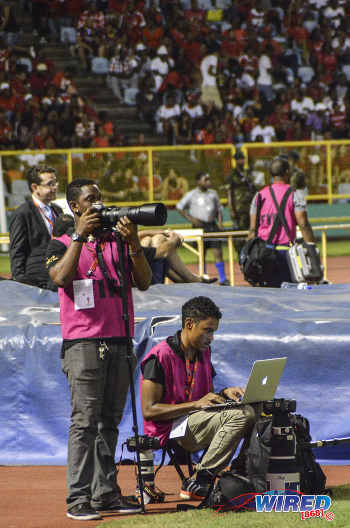 Photo: Wired868 photographers Allan V Crane (right) and Chevaughn Christopher on spot at the Hasely Crawford Stadium. (Courtesy Allan Powder/Wired868)