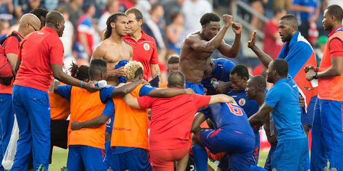 Photo: The Haiti football team celebrates after a 1-0 triumph over Honduras during the 2015 Gold Cup tournament. (Courtesy MexSport/CONCACAF)