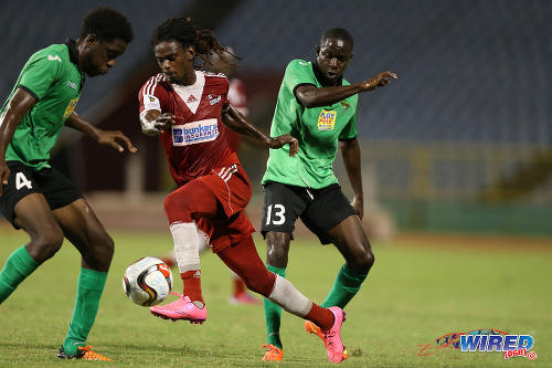 Photo: Central FC winger Jason Marcano (centre) tries to find a way past San Juan Jabloteh players Fabian Reid (right) and Garth Thomas during 2015 Pro League action last night at the Hasely Crawford Stadium. (Courtesy Kerlon Orr/CA-images/Wired868)