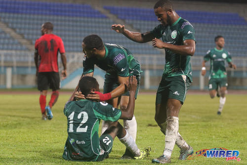 Photo: W Connection attacker Jomal Williams (right) and goal scorer Shahdon Winchester (centre) congratulate the seated Dimitrie Apai on his assist during 2015/16 Pro League action yesterday in Couva. (Courtesy Chevaughn Christopher/Wired868)