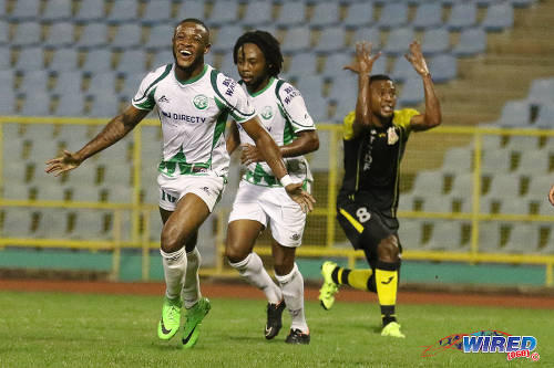 Photo: W Connection attacker Jomal Williams (left) celebrates his opening goal with teammate Andre Toussaint (centre) while Defence Force utility player Curtis Gonzales berates his defence in the 2015 Toyota Classic final. (Courtesy Chevaughn Christopher/Wired868)