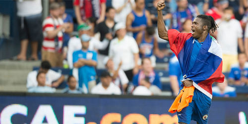 Photo: Haiti attacker Kervens Belfort celebrates his nation's win over Honduras during the 2015 CONCACAF Gold Cup. (Courtesy MexSport/CONCACAF)