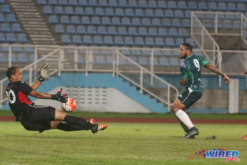 Photo: San Juan Jabloteh custodian and Grenada international Shemel Louison (left) denies W Connection attacker  Shahdon Winchester, just seconds after saving his penalty, during 2015/16 Pro League action yesterday in Couva. (Courtesy Chevaughn Christopher/Wired868)
