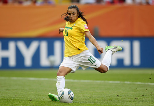 Photo: Brazil star Marta drives a shot at goal. Marta scored five times tonight as Brazil routed Trinidad and Tobago 11-0.