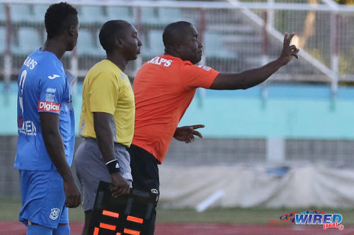 Photo: Naparima College coach Angus Eve (right) prepares to introduce left back Khris Stroud (left) during the 2015 National Intercol final. (Courtesy Chevaughn Christopher/Wired868)