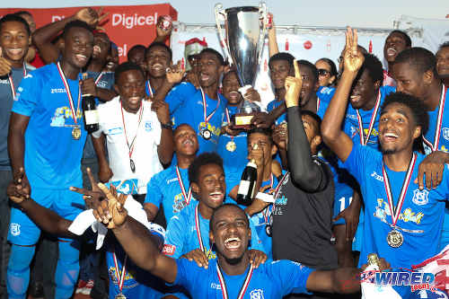 Photo: Naparima College celebrate their 2015 National Intercol title after yesterday's 2-0 win over St Anthony's College in Marabella. (Courtesy Chevaughn Christopher/Wired868)