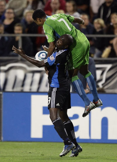 Photo: San Jose Earthquake's Cornell Glen (left) holds off Seattle Sounders' James Riley during MLS action. (Copyright AFP 2015/Ezra Shaw)