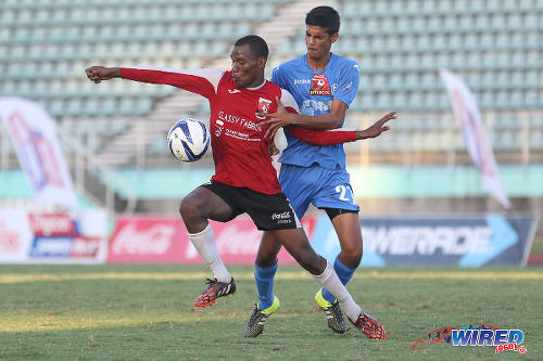 Photo: St Anthony's College utility player Shakeem Patrick (left) keeps the ball away from Naparima College midfielder Justin Sadoo during the 2015 National Intercol final. (Courtesy Chevaughn Christopher/Wired868)