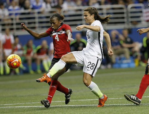 Photo: United States player Stephanie McCaffrey (right) goes for goal under pressure from Trinidad and Tobago defender Danielle Blair in international friendly action on Thursday December 10. (Copyright AFP 2015/Chris Covatta)