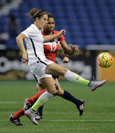 Photo: Trinidad and Tobago defender Victoria Swift (right) tries to close down a United States player during international friendly action on Thursday December 10. (Courtesy TTFA Media)