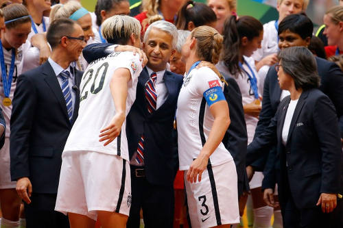 Photo: United States Soccer Federation (USSF) president Sunil Gulati (centre) hugs national women players Abby Wambach (left) and Christie Rampone after their 2015 World Cup final win over Japan. (Copyright AFP 2015/Kevin C Cox)