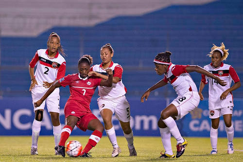 Photo: Canada Under-20 attacker Taylor Pryce tries to get a shot off under pressure from Trinidad and Tobago players (from right) Chevonne John, Naoemi Guerra, Amaya Ellis and Shaunalee Govia during 2015 CONCACAF Under-20 Championship action. (Copyright MexSport/CONCACAF)